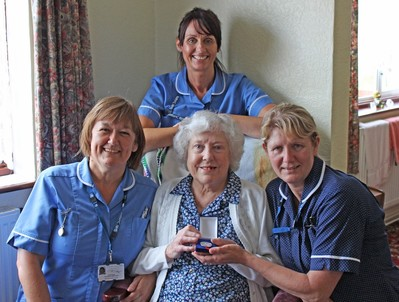 three nurses with a service user