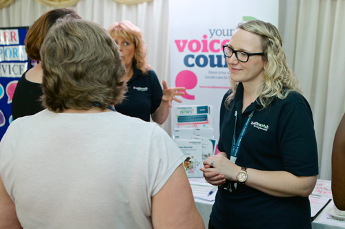 nhs staff talking to member of public at event