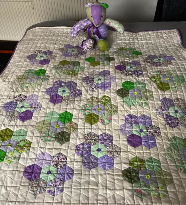 Hand sewn quilt and teddy bear, by Lesley Ewok