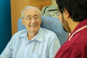 A patient at Lings Bar Hospital talking to a member of staff.