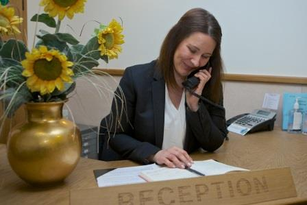 lady on reception on the phone