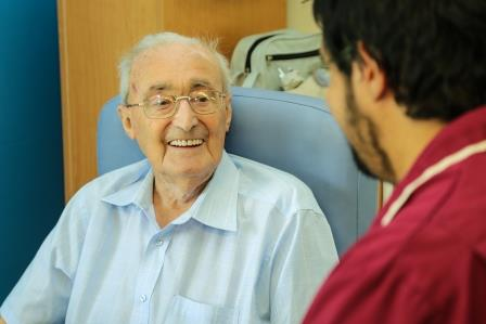 Patient talking to staff member