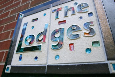 The sign for The Lodges at Wathwood Hospital