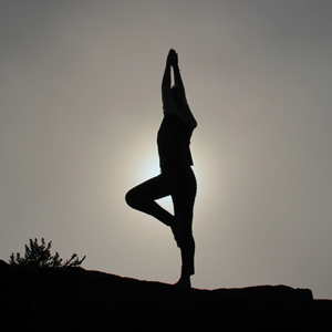 A silhouette of a person in a yoga pose