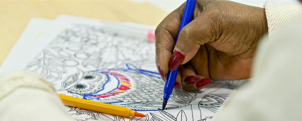 An person doing some adult colouring