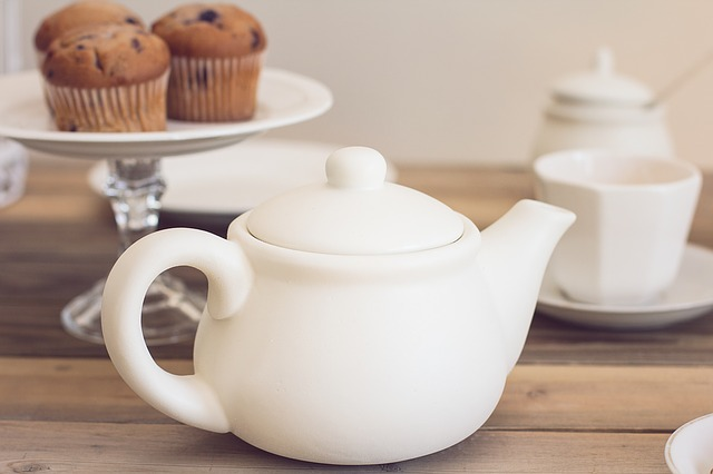 A teapot and some muffins