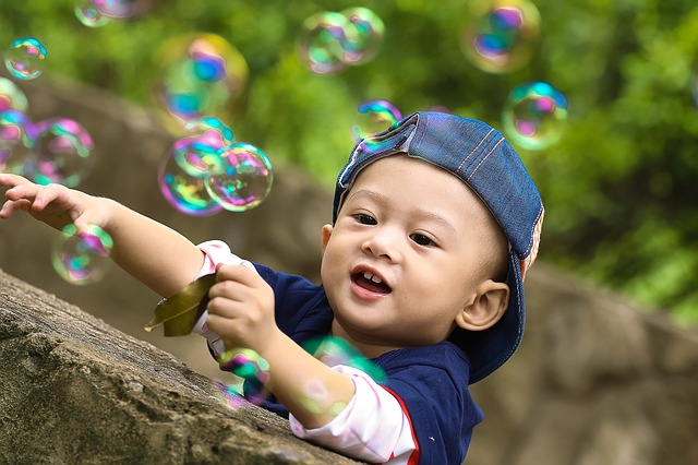 A young boy with bubbles