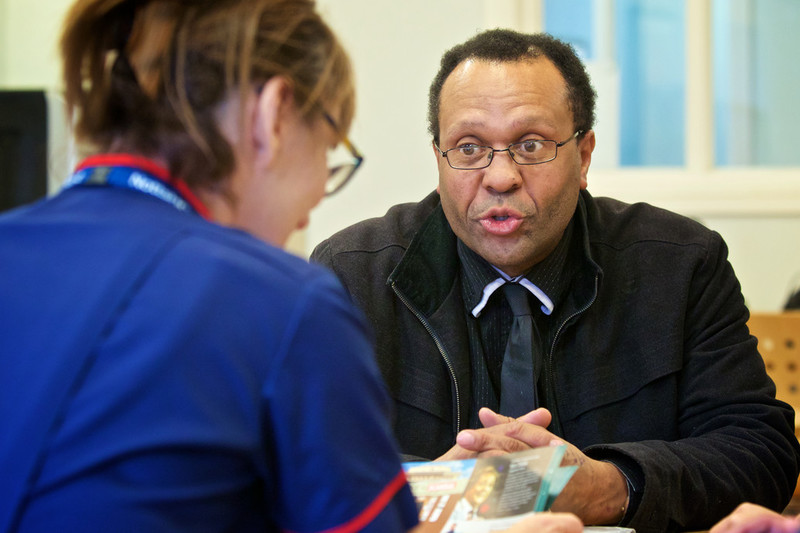 A man talking to a member of staff