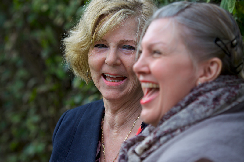 Two women laughing with each other